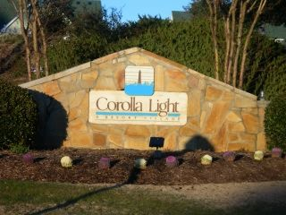 the entrance sign to Corolla Light subdivision