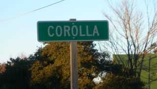 Corolla Village sign
