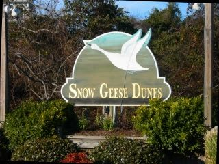 The entrance sign to Snow Geese Dunes Subdivision